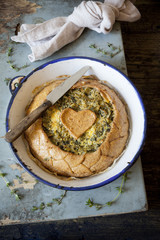 spinach and chicory savory pie on vintage plate on rustic table