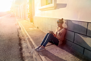 Girl sitting in the sun