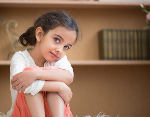 Portrait of cute little hispanic girl