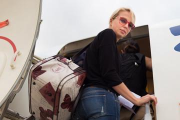 Woman boarding airplane.
