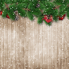 Christmas fir tree on snowy wooden background
