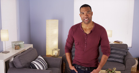 Handsome Black man standing in living room