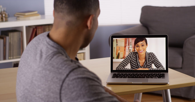African couple talking to each over via internet