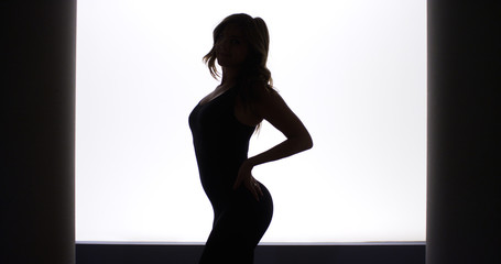Silhouette of pretty woman