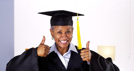 Proud mature African woman graduate