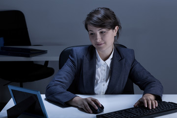Smiling businesswoman looking at picture