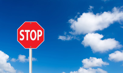 roadside red stop sign on a cloudy background.