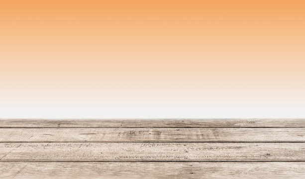 orange background with wooden planks