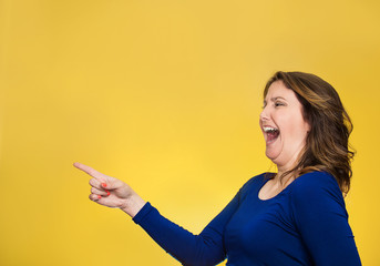 happy laughing woman pointing finger at something