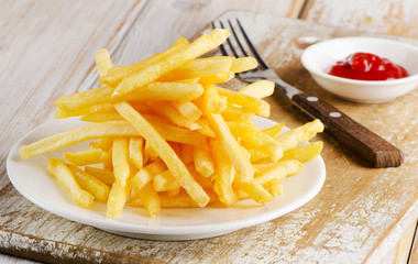 fries on a  wooden board