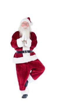 Father Christmas doing some yoga