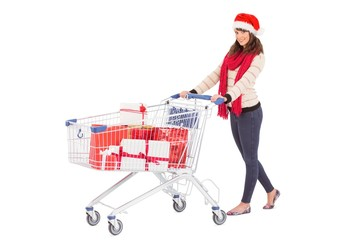 Brunette in santa hat with shopping trolley