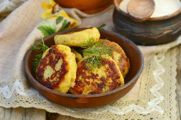 potato patties with fried  bacon  and onions.