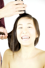 Asian woman ready to shave her hair smiling