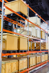 Cargo box on steel shelf system in warehouse