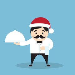 Chef in Santa's hat with cloche and towel