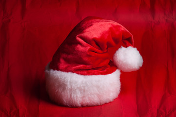 Santa Claus red hat on red background