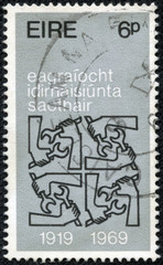 stamp printed in Ireland shows Quadruple I.L.O. Emblems,