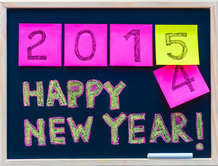 Happy New Year 2015 message on blackboard, celebration concept