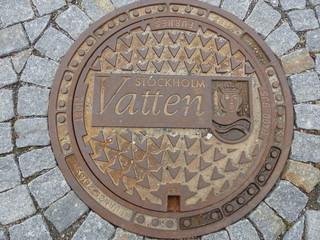Plaque d'égouts artistique à Stockholm en suède