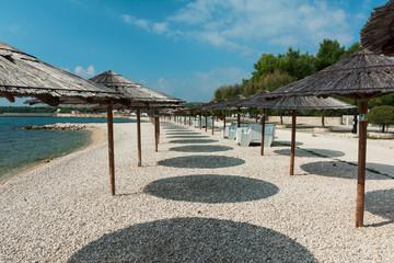 Parasols, beach Vir, Croatia
