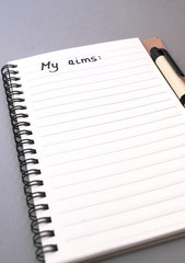 Hand drawing aims list on notebook
