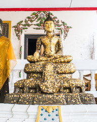 Image of Buddha with gold leaf