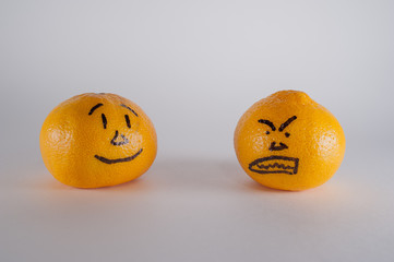 two Mandarin with painted faces evil and the good
