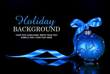 Christmas background with a blue ornament and ribbon