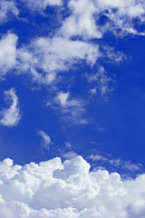 Sky background with the fluffy white clouds
