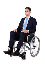 Portrait Of Confident Businessman Sitting In Wheelchair
