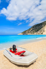 Pontoon boat on idyllic Myrtos beach, Kefalonia island, Greece