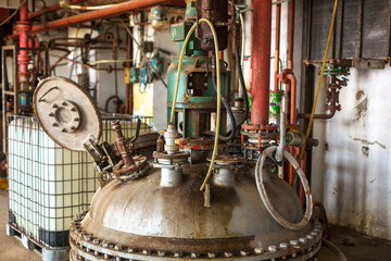 Industrial interior with storage tank