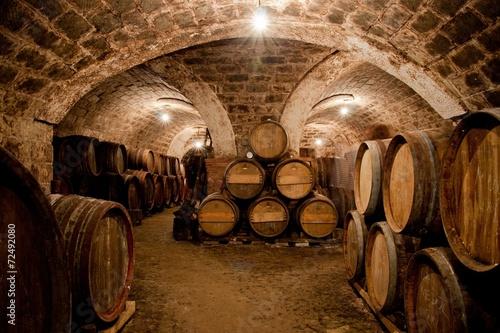 Wall mural Barrels in a hungarian wine cellar