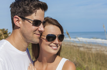Happy Man Woman Couple in Sunglasses At Beach