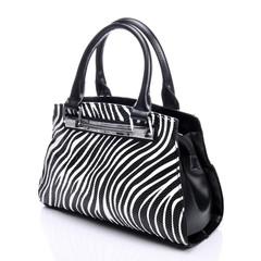 Handbag in zebra pattern on a white background