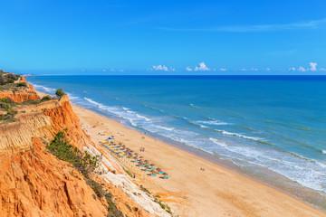 Sunny beach summer sea Albufeira in Portugal.