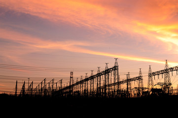 Sunset over an electrical substation