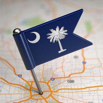 South Carolina Small Flag on a Map Background.