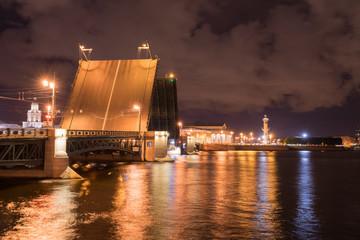 Open drawbridge at night in St. Petersburg Russia