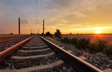 Fotorollo Eisenbahnschienen Railway at sunset
