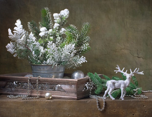 Christmas vintage still life with deer and christmas decorations