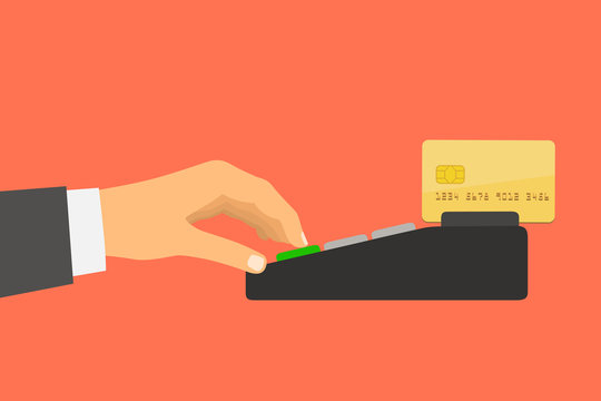 Hand holding a credit card spends in the payment terminal