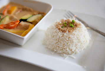 The plate of boiled rice with meat on white plate