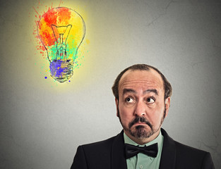 confused puzzled man looking up searching for brilliant idea