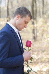 handsome man with a rose