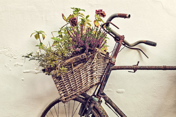 Retro styled image of an old bicycle with basket