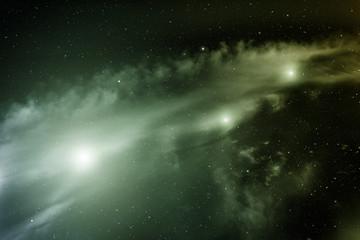 Space with nebula and three bright stars.