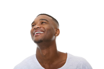 Close up portrait of a happy young african american man laughing