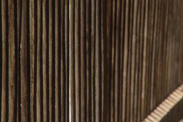 Old wooden vertical planks with horizontal slats left side focus